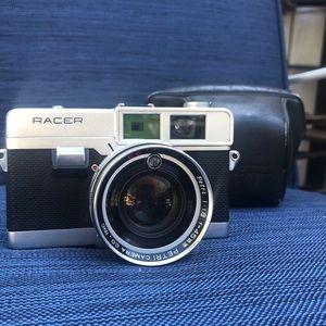 A 1966 Petri Racer camera w/ original case.